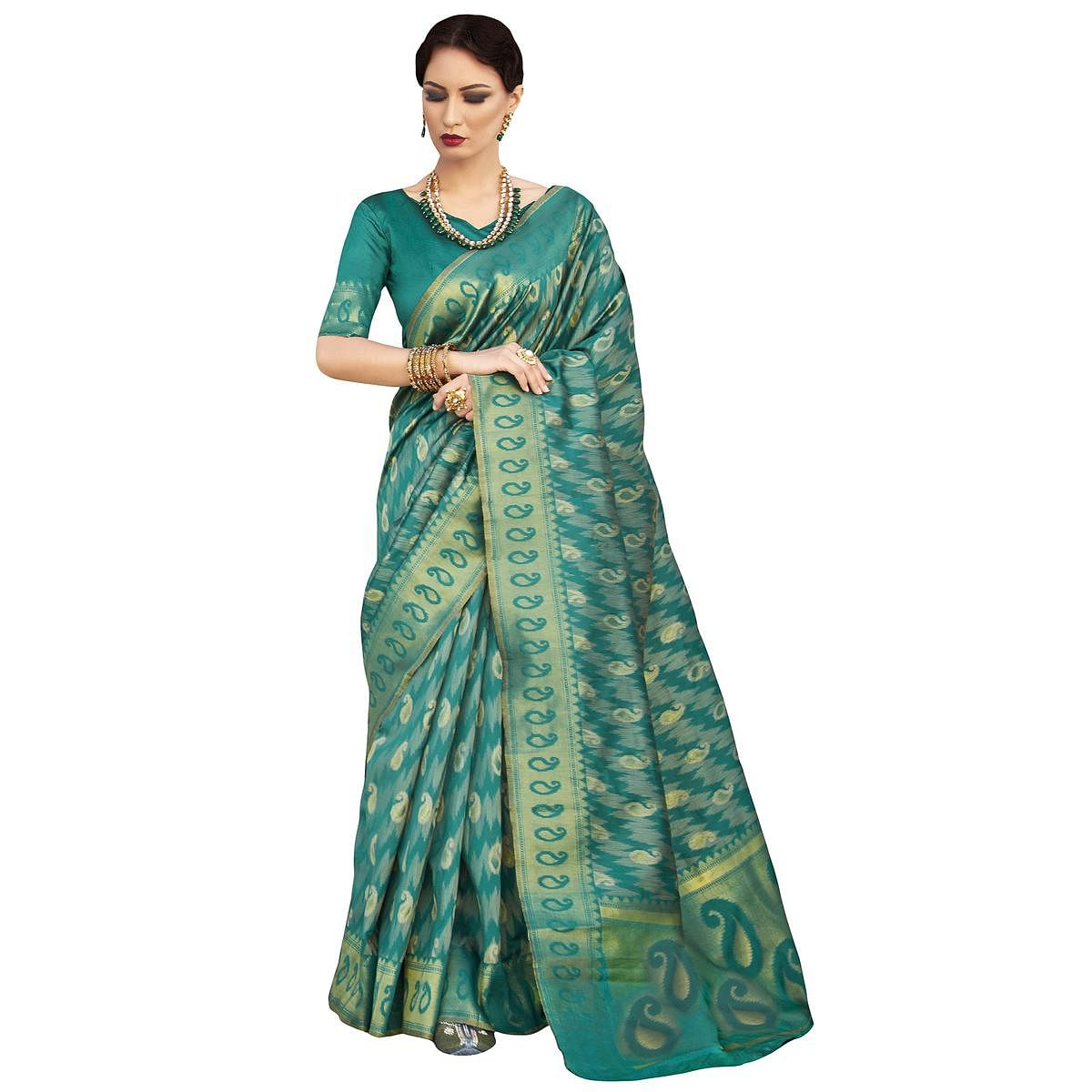 Exceptional Teal Green Colored Festive Wear Woven Ikkat Silk Saree