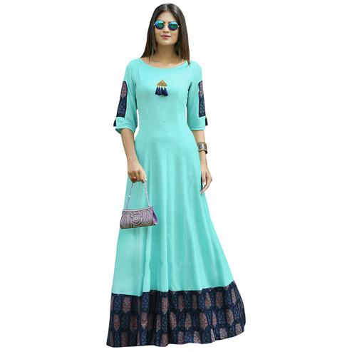 Mesmeric Aqua Blue Colored Partywear Printed Rayon Long Kurti