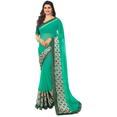 Blooming Aqua Green Colored Casual Printed Silk Saree