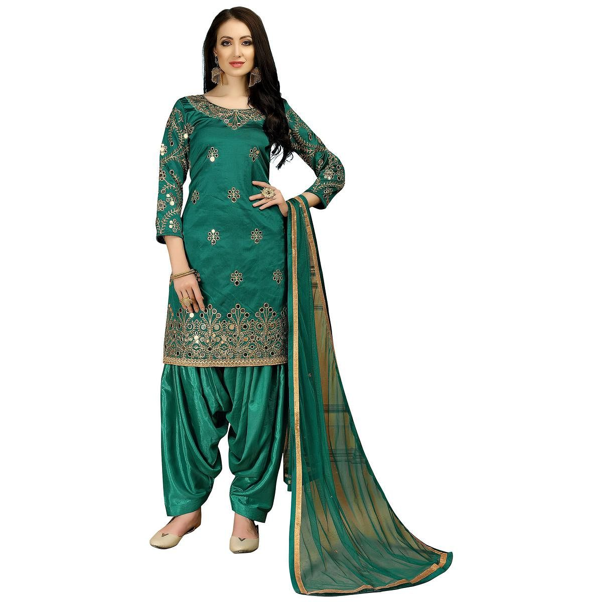 Glowing Turquoise Green Colored Partywear Embroidered Tapeta Silk Suit
