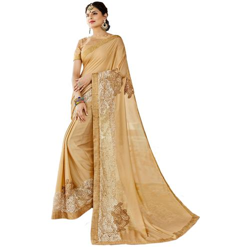 Pleasant Beige Colored Partywear Embroidered Art Silk Saree