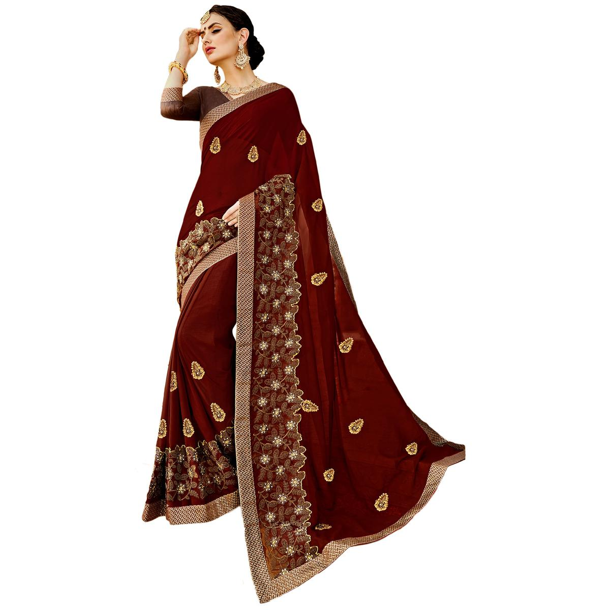 Amazing Maroon Colored Partywear Embroidered Georgette Saree