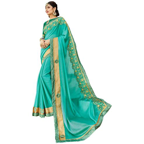 Glowing Turquoise Blue Colored Partywear Embroidered Chiffon Silk Saree