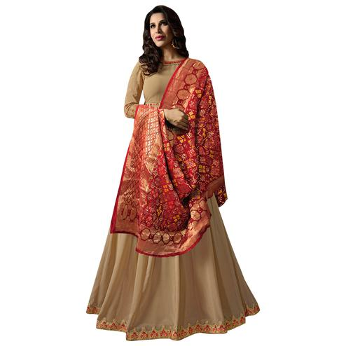Mesmerising Beige Colored Embroidered Georgette Anarkali Suit With Pure Banarasi Silk Dupatta