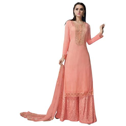 Appealing Peach Colored Partywear Embroidered Georgette Suit