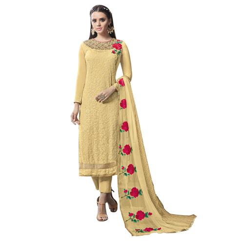 Adorning Yellow Colored Partywear Embroidered Georgette Suit