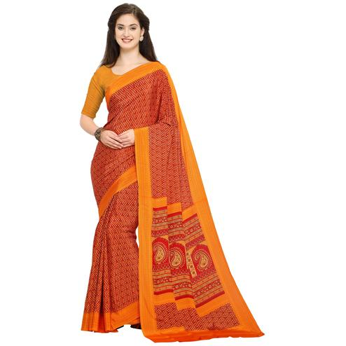 Lovely Orange Colored Casual Printed Crepe Saree