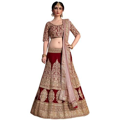 Traditional Maroon Colored Partywear Embroidered Velvet Silk Lehenga Choli