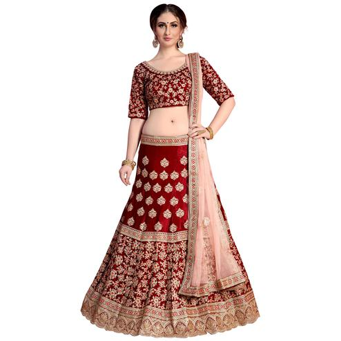 Flattering Maroon Colored Partywear Embroidered Velvet Silk Lehenga Choli
