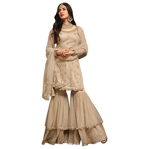 Attractive Off-White Colored Partywear Embroidered Netted Palazzo Suit