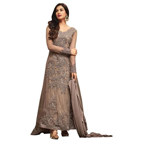 Gleaming Gray Colored Partywear Embroidered Netted Anarkali Suit