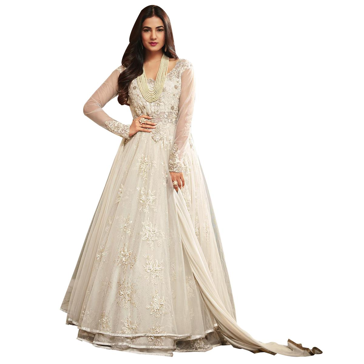 Glowing White Colored Partywear Embroidered Netted Anarkali Suit