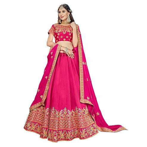 Arresting Hot Pink Colored Partywear Embroidered Heavy Silk Lehenga Choli