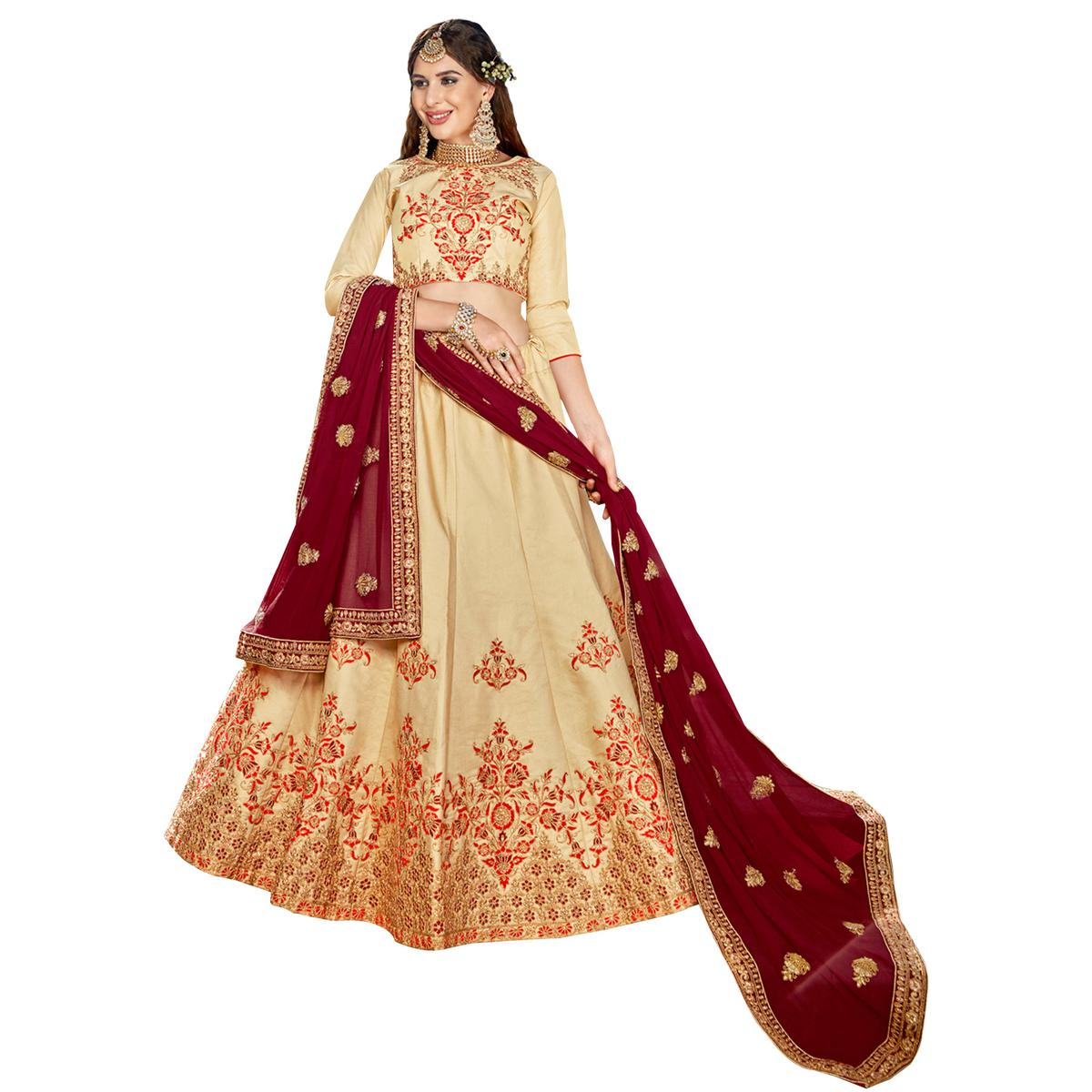 Appealing Beige Colored Partywear Embroidered Heavy Silk Lehenga Choli