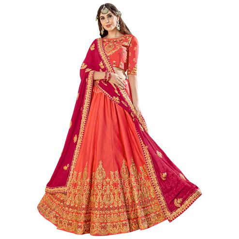 Hypnotic Peach Colored Partywear Embroidered Heavy Silk Lehenga Choli