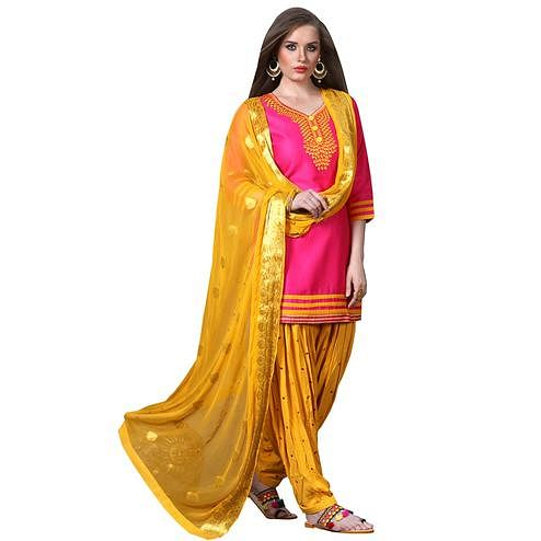 Charming Pink Colored Partywear Embroidered Soft Silk Patiala Suit