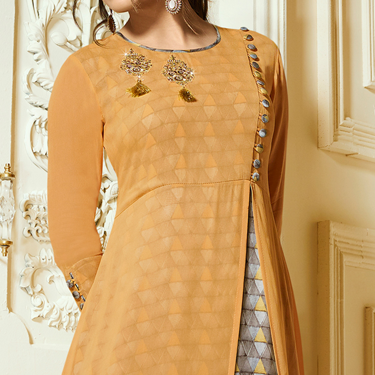 Different Light Orange Colored Partywear Embroidered Georgette Kurti