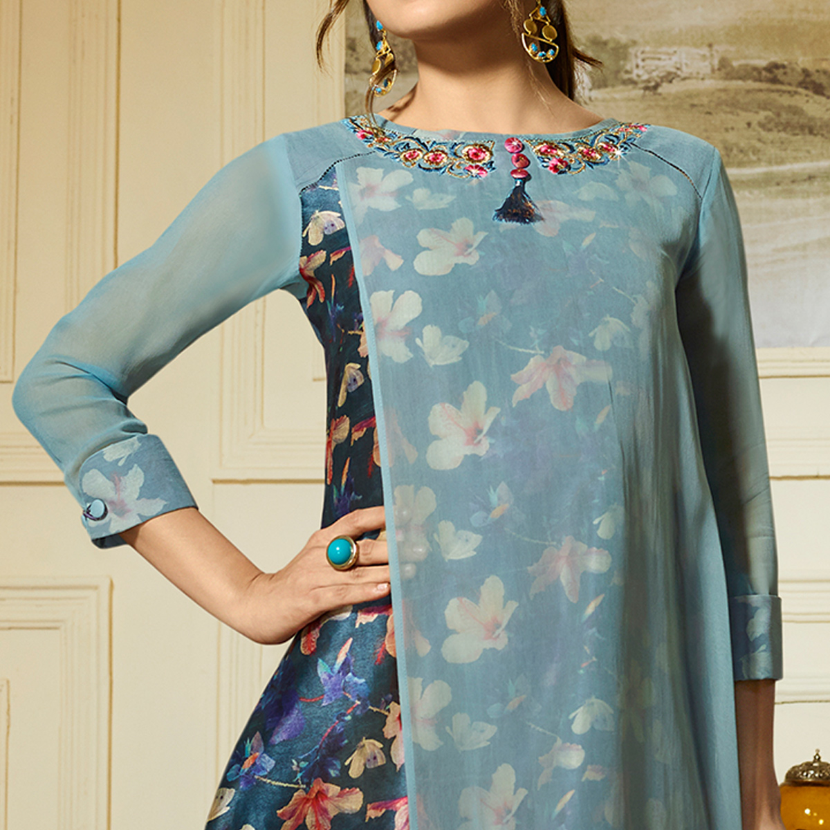 Innovative Pastel Blue Colored Partywear Embroidered Georgette Kurti