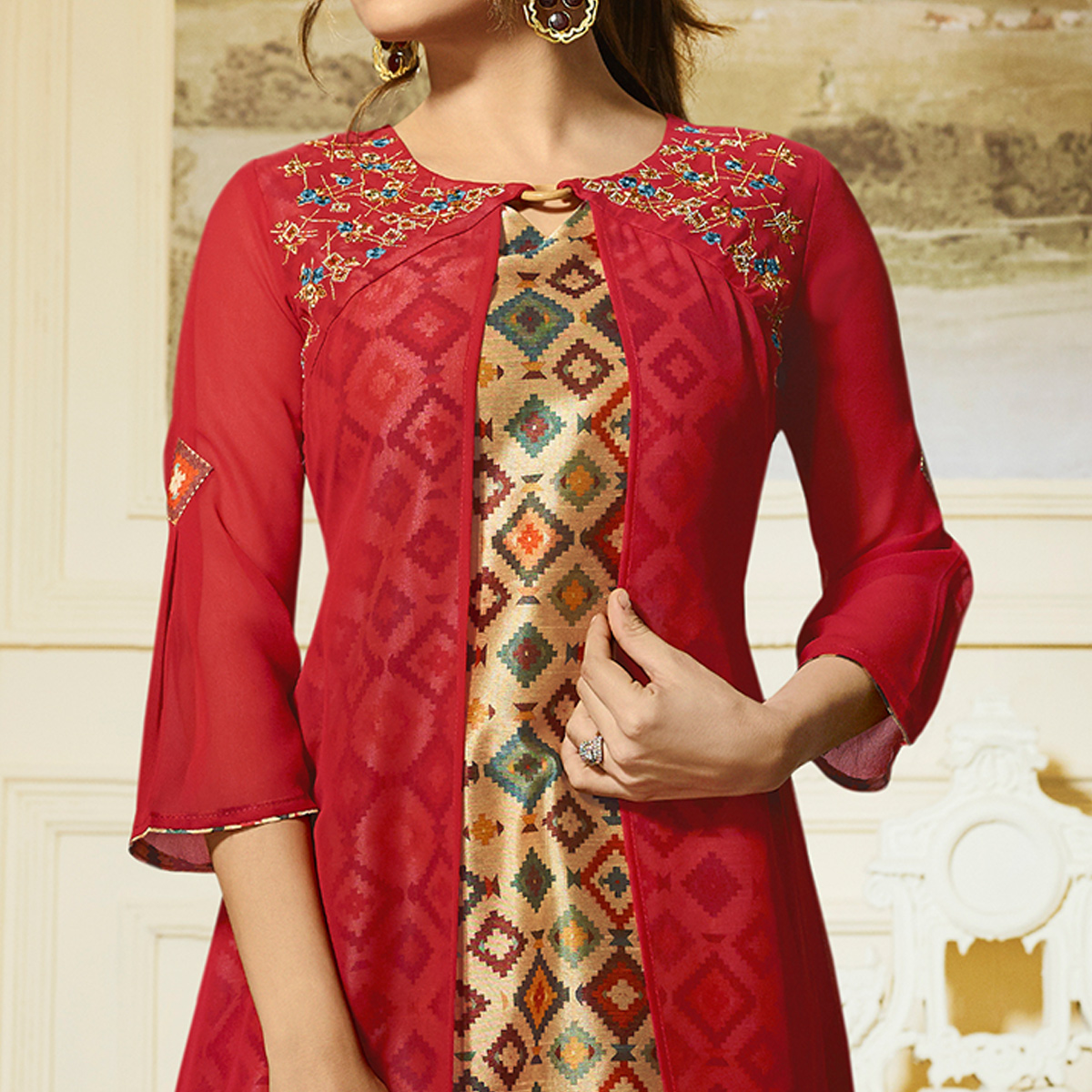 Staring Red Colored Partywear Embroidered Georgette Kurti