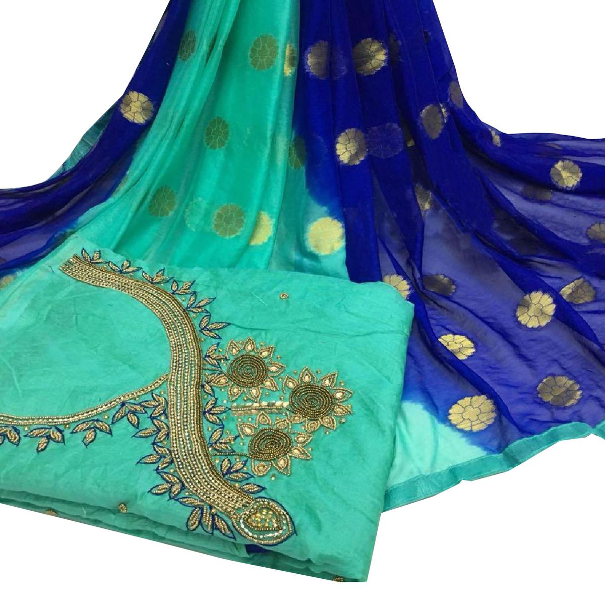 Stunning Rama Green Colored Partywear Embroidered Modal Chanderi Cotton Dress Material