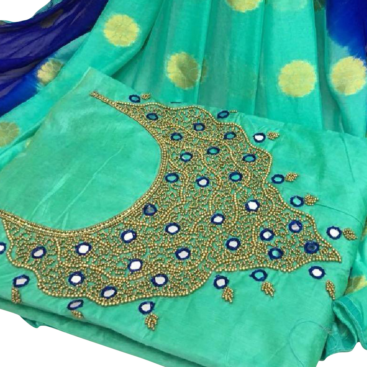 Blooming Rama Green Colored Partywear Embroidered Modal Chanderi Silk Dress Material