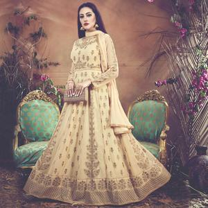 Prominent Cream Colored Embroidered Partywear Faux Georgette Anarkali Suit