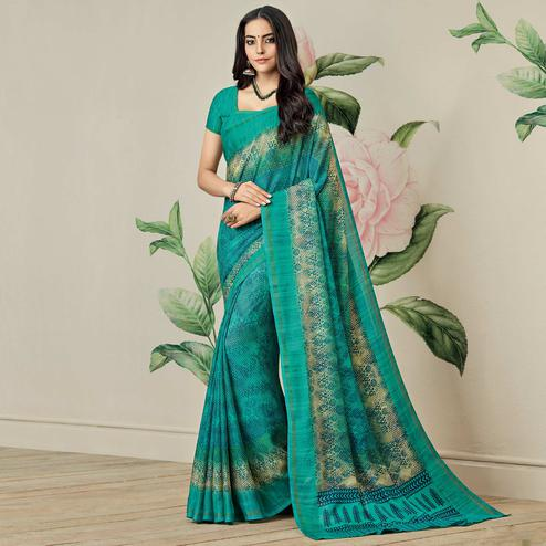 Pretty Sea Green Colored Casual Printed Jute Art Silk Saree