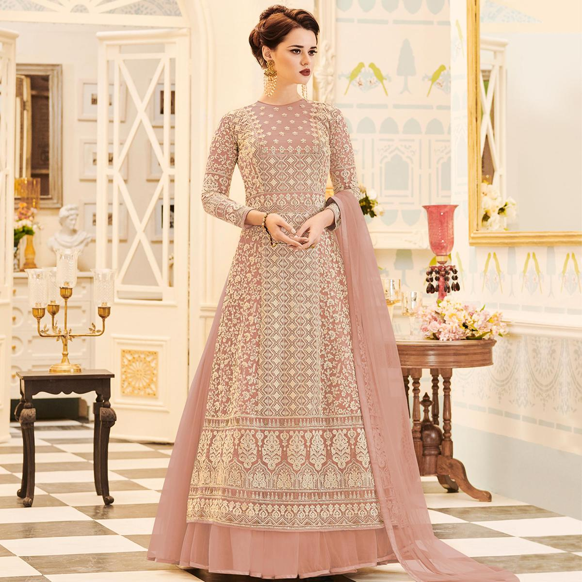 Adorning Peach Colored Party Wear Embroidered Work Net Anarkali Suit
