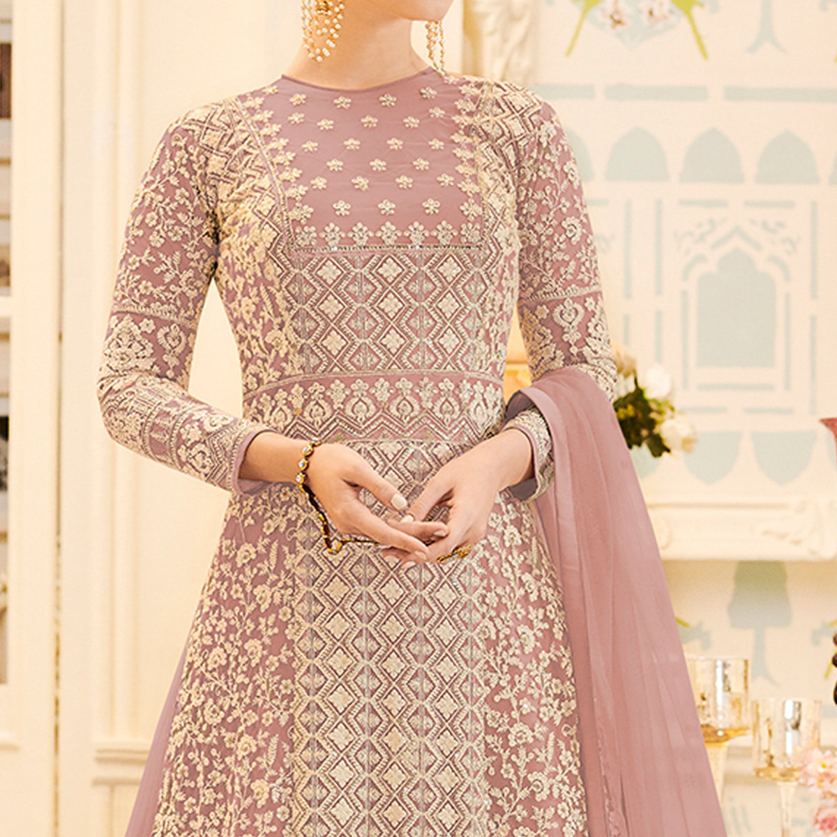 Energetic Pastel Pink Colored Party Wear Embroidered Work Net Anarkali Suit