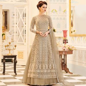 Snazzy Light Brown Colored Party Wear Embroidered Work Net Anarkali Suit