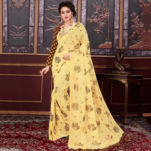 Attractive Yellow Colored Party Wear Printed Fancy Net Saree