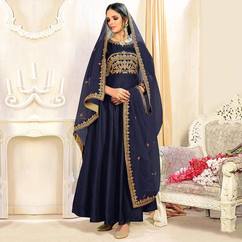 Glowing Royal Blue Colored Partywear Embroidered Tapeta Silk Anarkali Suit