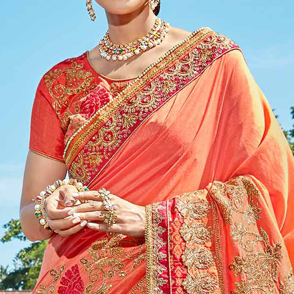 Pleasant Peach Colored Designer Embroidered Party Wear Art Silk Saree