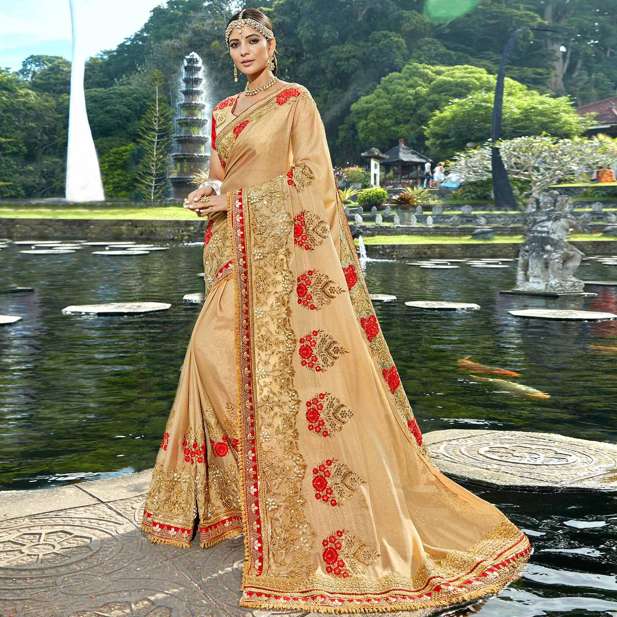 Ravishing Beige Colored Designer Embroidered Party Wear shimmer Fancy Fabric Saree