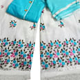 Blooming Sky Blue Colored Partywear Embroidered Rayon Palazzo Suit