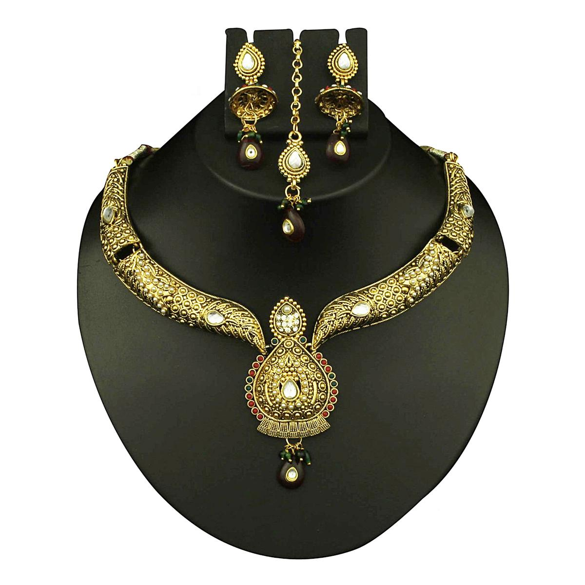 Kundan Austrian Stone Red & Green Pota Pearl Gold Finish Necklace Set With Maang Tikka