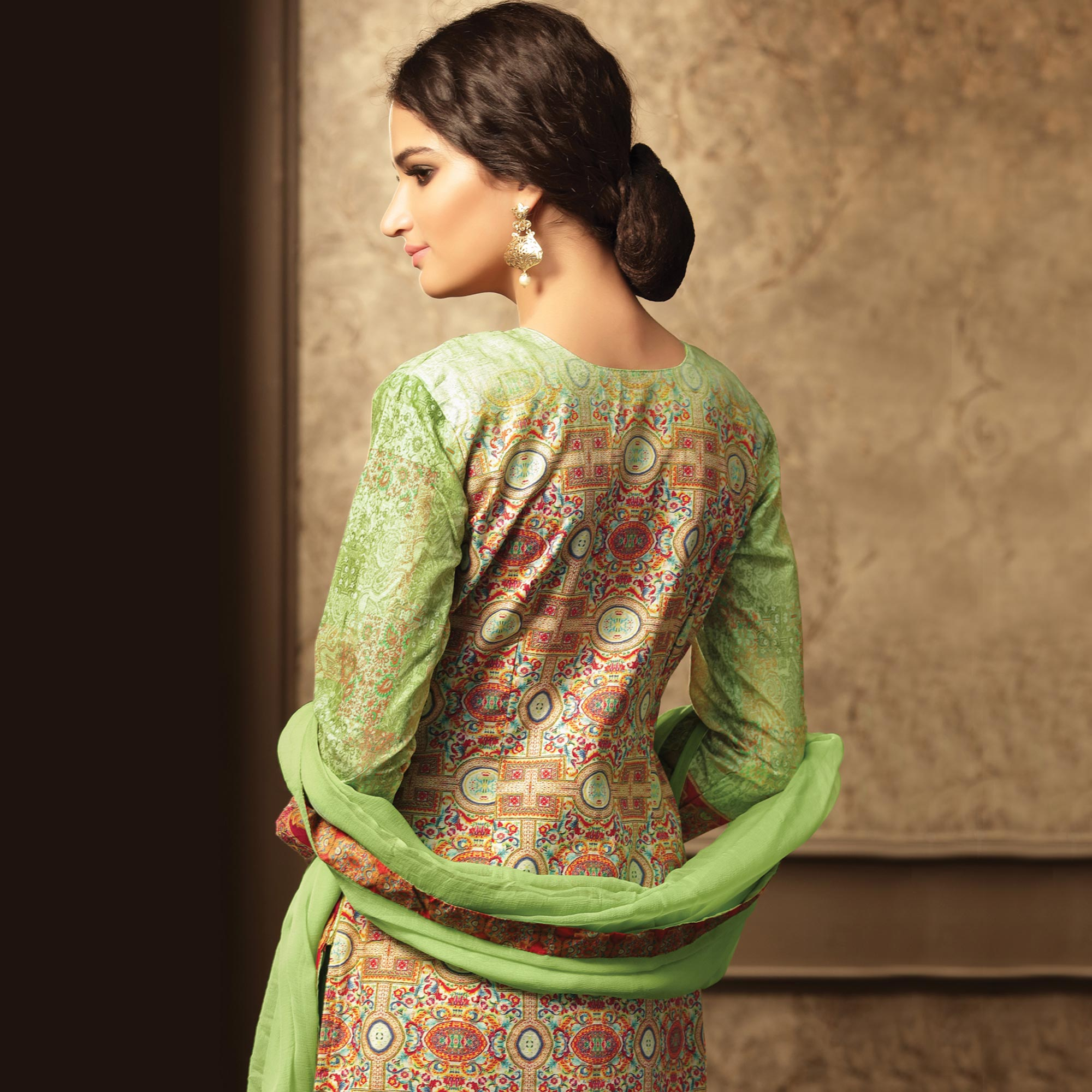 Graceful Pista Green Colored Party Wear Embroidered Cotton Suit