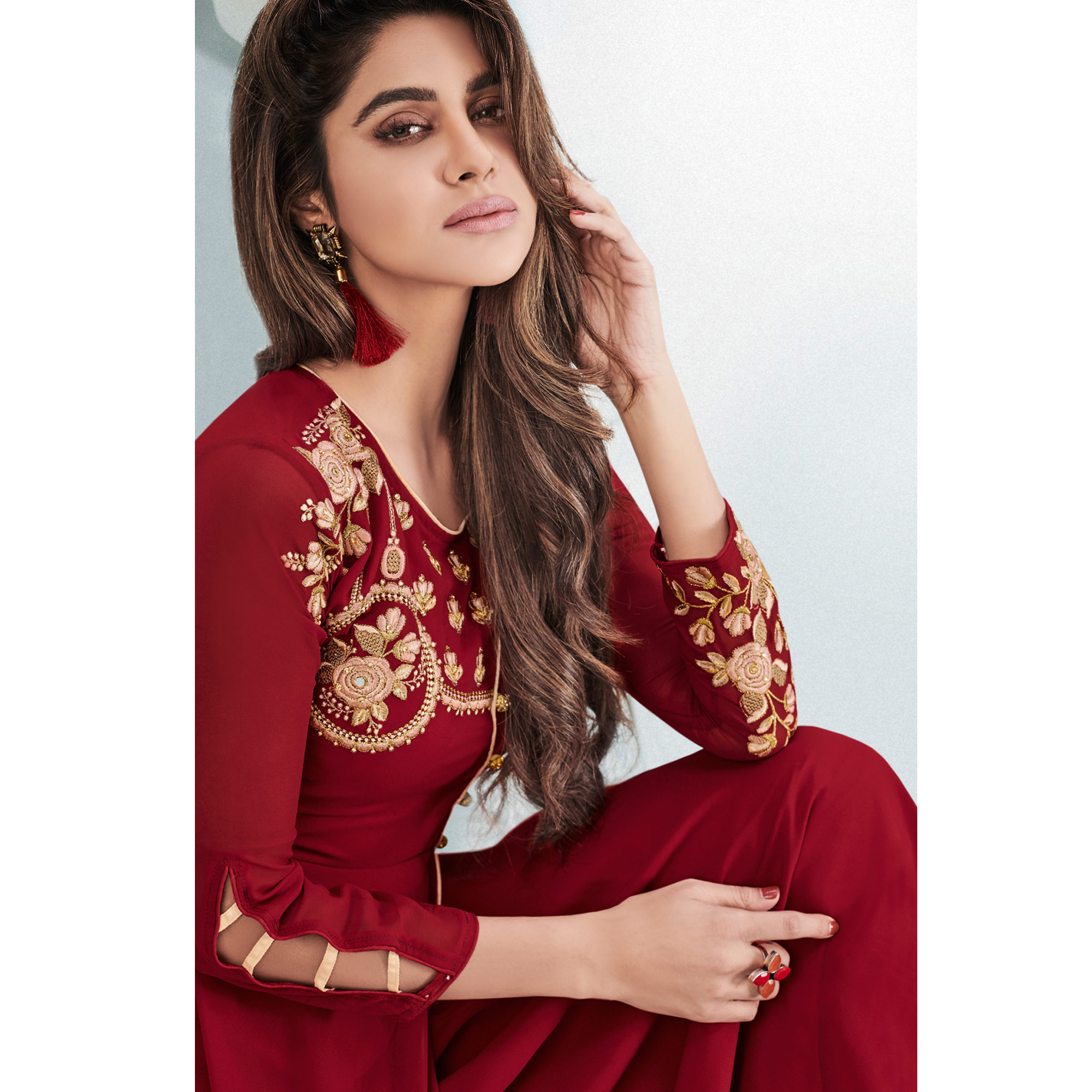 Imposing Maroon Colored Partywear Embroidered Georgette Gown