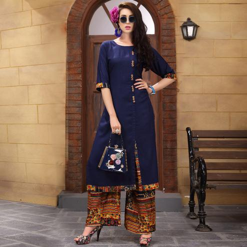 Eye-Catching Navy Blue Colored Partywear Printed Rayon Palazzo Suit