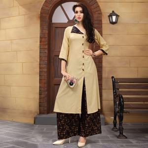 Stylish Beige Colored Partywear Printed Rayon Palazzo Suit