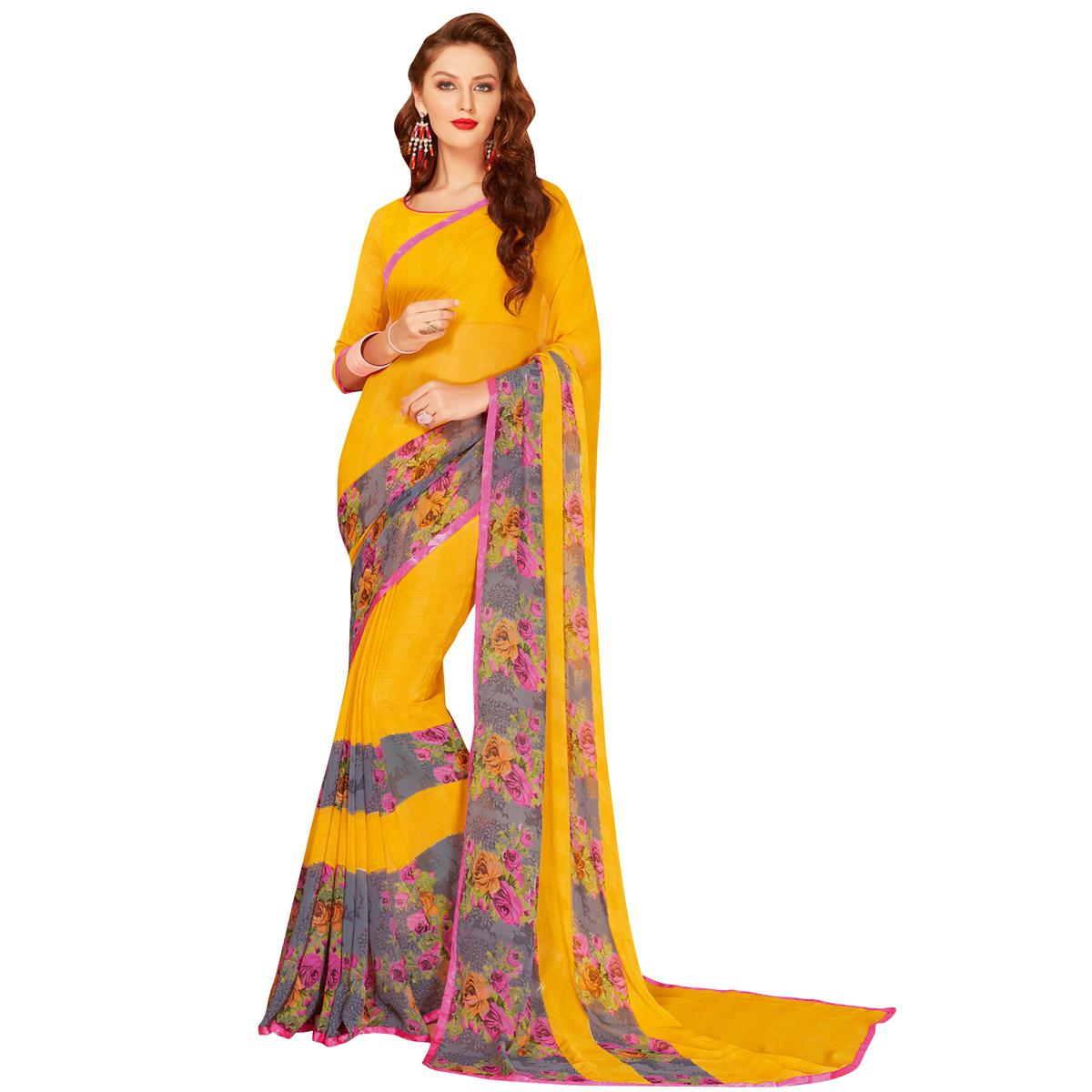 Staring Yellow Colored Casual Wear Printed Georgette Saree