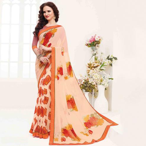 Amazing Light Peach Colored Casual Wear Printed Georgette Saree