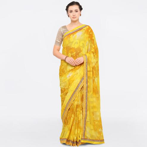 Intricate Yellow Colored Party Wear Georgette Brasso Saree