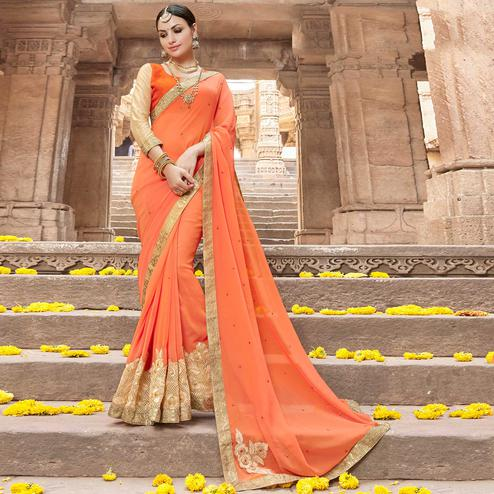 Dazzling Orange Colored Party Wear Embroidered Georgette Saree