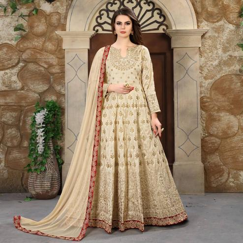 Appealing Cream Colored Partywear Embroidered Mulberry Silk Anarkali Suit