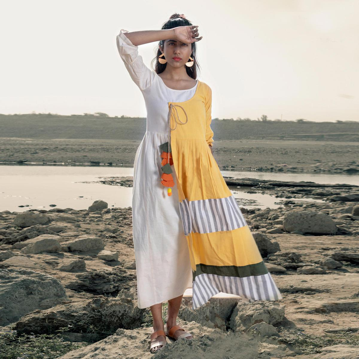 Stylish White-Yellow Colored Partywear Printed Cotton Long Kurti