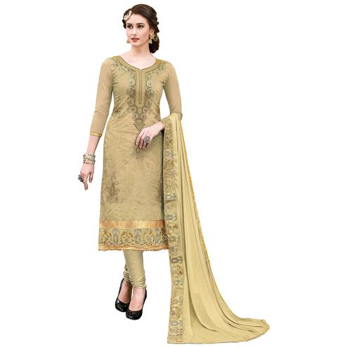 Pleasant Beige Colored Partywear Embroidered Modal Dress Material
