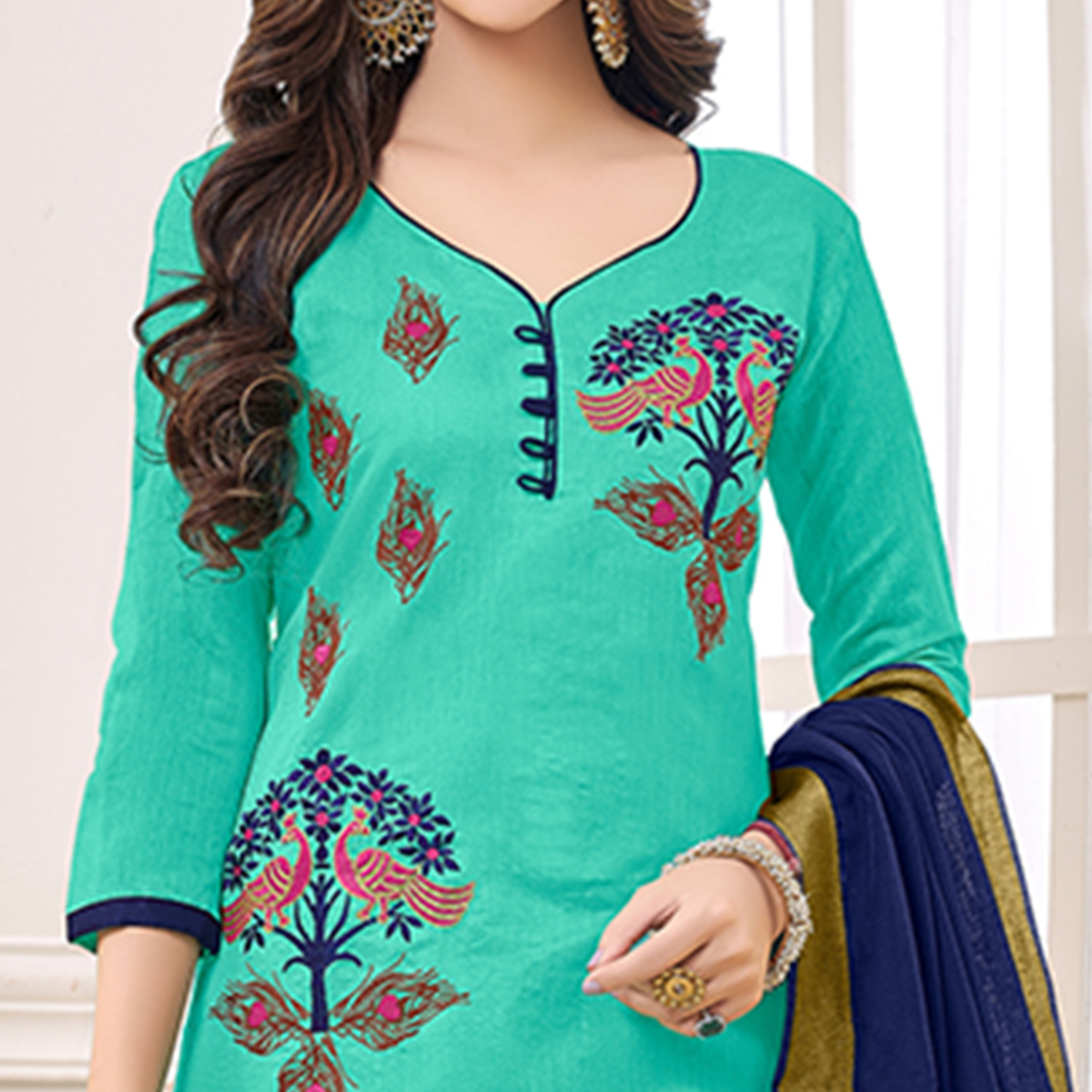 Attractive Turquoise Green Colored Partywear Embroidered Cotton Dress Material