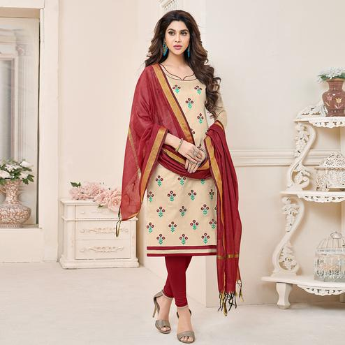 Appealing Beige Colored Partywear Embroidered Cotton Dress Material