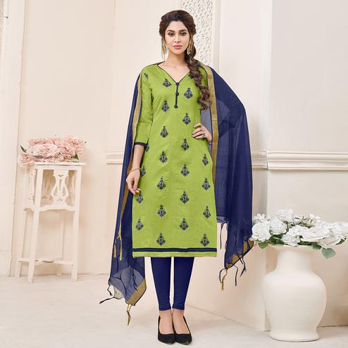 Glowing Green Colored Partywear Embroidered Cotton Dress Material